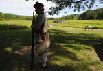 "FILE - In this July 3, 2018, file photo, reenactor Braxton Berkey stands in the shade at Fort Necessity National Battlefield near Farmington, Pa. Fort Necessity is the spot in Southwestern Pennsylvania's forested hills where an early ""world war"" among the English, the French and Native Americans began. (John Rucosky/The Tribune-Democrat via AP, File)"