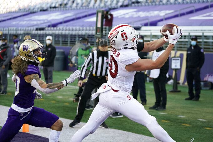 Stanford tight end Scooter Harrington, right, catches a touchdown pass as Washington's Asa Turner trails him in the second half of an NCAA college football game Saturday, Dec. 5, 2020, in Seattle. (AP Photo/Elaine Thompson)