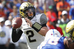 Vanderbilt quarterback Deuce Wallace (2) looks for a receiver against Florida during the first half of an NCAA college football game, Saturday, Nov. 9, 2019, in Gainesville, Fla. (AP Photo/John Raoux)