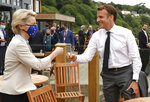 European Commission President Ursula von der Leyen, left, greets French President Emmanuel Macron with a fist bump during an EU coordination meeting prior to the G7 meeting at the Carbis Bay Hotel in Carbis Bay, St. Ives, Cornwall, England, Friday, June 11, 2021. Leaders of the G7 begin their first of three days of meetings on Friday, in which they will discuss COVID-19, climate, foreign policy and the economy. (Phil Noble, Pool via AP)
