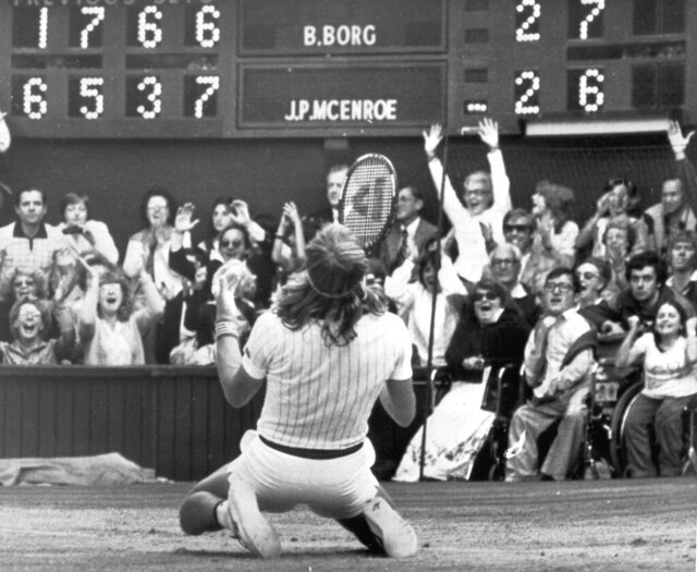 FILE - In this July 5, 1980, file photo, Sweden's Bjorn Borg falls to his knees in front of the scoreboard on the Centre Court at Wimbledon after beating American John McEnroe, 1-6, 6-3, 7-5, 6-7, 8-6, to take the men's singles final for the fifth year in a row. (AP Photo/Robert Dear, File)