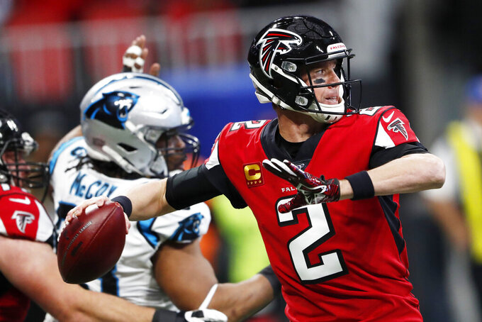 FILE - In this Dec. 8, 2019, file photo, Atlanta Falcons quarterback Matt Ryan (2) works in the pocket against the Carolina Panthers during the first half of an NFL football game in Atlanta. Ryan joined other Falcons players in a video that noted the legacy of the civil rights icon John Lewis, whose death last month reacquainted Americans with an enormously consequential figure in the fight for voting rights and social justice. (AP Photo/John Bazemore, File)