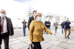 German Chancellor Angela Merkel arrives at the Bundestag for the meeting of the CDU/CSU parliamentary group in Berlin, Germany, Tuesday, April 13, 2021. (Christoph Soeder/dpa via AP)
