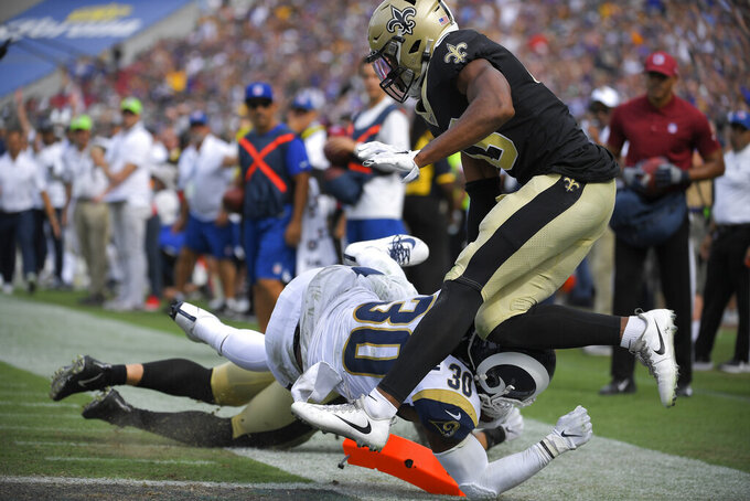 Los Angeles Rams running back Todd Gurley (30) scores past New Orleans Saints free safety Marcus Williams during the second half of an NFL football game Sunday, Sept. 15, 2019, in Los Angeles.. (AP Photo/Mark J. Terrill)