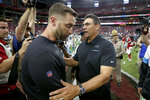 Carolina Panthers head coach Ron Rivera, right, greets Arizona Cardinals head coach Kliff Kingsbury after an NFL football game, Sunday, Sept. 22, 2019, in Glendale, Ariz. The Panthers won 38-20. (AP Photo/Ross D. Franklin)