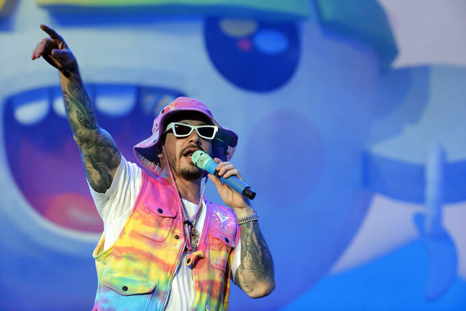FILE - In a Saturday, Nov. 23, 2019 file photo, singer J Balvin performs during the Coca-Cola Flow Reggaeton festival in Mexico City. Jennifer Lopez and Shakira will bring Latin music to the 2020 Super Bowl stage with two stars dominating the genre: J Balvin and Bad Bunny. (AP Photo/Ginnette Riquelme, File)