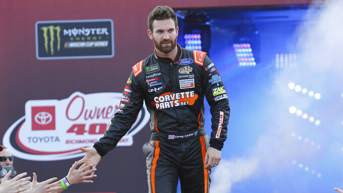 Corey LaJoie greets fans during driver introductions prior to the start of the NASCAR Cup series auto race at Richmond Raceway in Richmond, Va., Saturday, April 13, 2019. (AP Photo/Steve Helber)