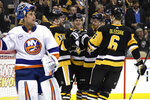 Pittsburgh Penguins' Riley Sheahan (15) celebrates his goal as New York Islanders goaltender Thomas Greiss (1) watches the replay on the scoreboard during the second period of an NHL hockey game in Pittsburgh, Thursday, Dec. 6, 2018. (AP Photo/Gene J. Puskar)