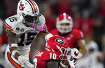 Georgia wide receiver Kearis Jackson (10) makes a reception next to Auburn defensive back Jordyn Peters (15) during the first half of an NCAA college football game Saturday, Oct. 3, 2020, in Athens, Ga. (AP Photo/Brynn Anderson)