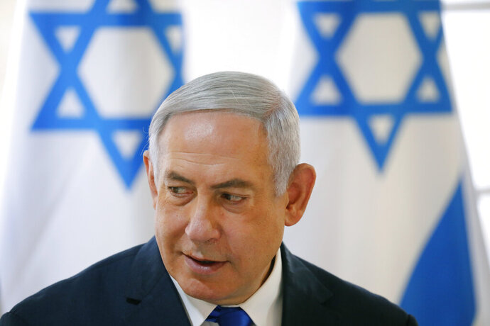 Israeli Prime Minister Benjamin Netanyahu chairs during the weekly cabinet meeting being held in the Jordan Valley, in the Israeli-occupied West Bank, Sunday, Sept. 15, 2019. Netanyahu convened his final pre-election cabinet meeting in a part of the West Bank that he's vowed to annex if re-elected. National elections are on Tuesday. (Amir Cohen/Pool via AP)