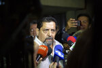 Edgar Zambrano, First Vice-President of the National Assembly, speaks to the press after being released from jail by the government of President Nicolas Maduro, in front of his home in Caracas Venezuela, Tuesday, Sept. 17, 2019. Zambarno had been jailed in the aftermath of the failed April 30th uprising. (AP Photo/Andrea Hernandez Briceño)