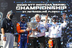 Scott Dixon, second from left, and Chip Ganassi, right, celebrate after winning the NTT IndyCar Series Championship following an IndyCar auto race Sunday, Oct. 25, 2020, in St. Petersburg, Fla. (AP Photo/Mike Carlson)