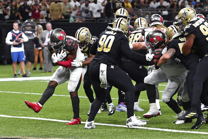 Tampa Bay Buccaneers running back Peyton Barber (25) carries into the end zone for a touchdown in the second half of an NFL football game against the New Orleans Saints in New Orleans, Sunday, Oct. 6, 2019. (AP Photo/Bill Feig)