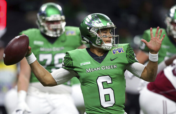 FILE - In this Dec. 16, 2017, file photo, North Texas quarterback Mason Fine (6) passes in the first half of the New Orleans Bowl NCAA college football game against Troy in New Orleans. The high-flying offenses of Utah State and North Texas meet in the New Mexico Bowl in what is expected to be a passing attack shootout. Utah State is making its seventh college postseason appearance in eight years while North Texas tries to give head coach Seth Littrell his first bowl victory. (AP Photo/Gerald Herbert, File)