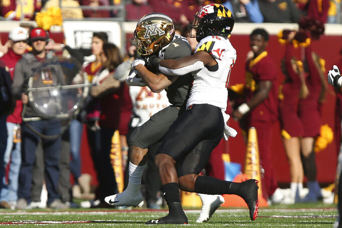 Minnesota running back Rodney Smith (1) is tackled by Maryland linebacker Ayinde Eley (16) during an NCAA college football game Saturday, Oct. 26, 2019, in Minneapolis. (AP Photo/Stacy Bengs)
