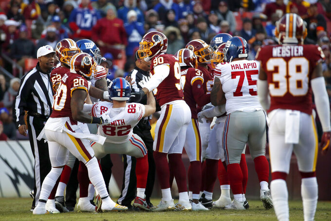 Washington Redskins strong safety Landon Collins (20) tugs on New York Giants tight end Kaden Smith (82) during an argument in the first half of an NFL football game, Sunday, Dec. 22, 2019, in Landover, Md. (AP Photo/Alex Brandon)