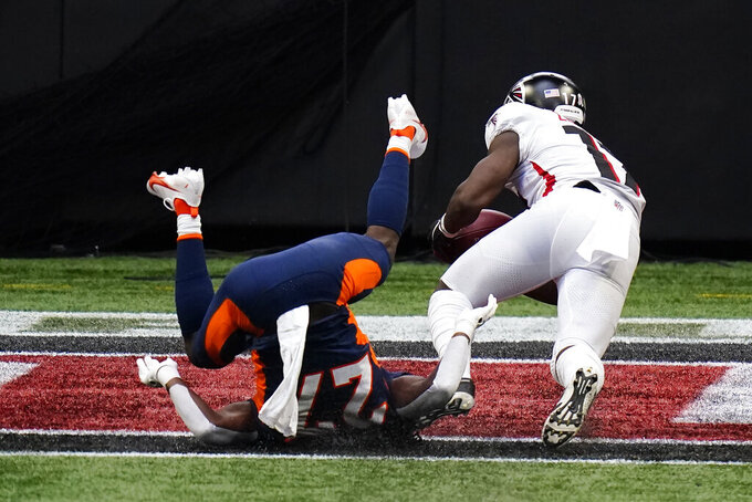 Atlanta Falcons wide receiver Olamide Zaccheaus (17) makes a touchdown catch against the Denver Broncos during the first half of an NFL football game, Sunday, Nov. 8, 2020, in Atlanta. (AP Photo/Brynn Anderson)
