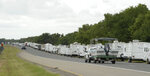 Recreational trailers and boats are parked along LA-46 inside the levee gates in anticipation of Tropical Storm Cristobal in St. Bernard Parish, La., Saturday, June 6, 2020. A re-energized Tropical Storm Cristobal advanced toward the U.S. Gulf Coast early Saturday, bringing with it the heavy rains that already caused flooding and mudslides in Mexico and Central America. (Max Becherer/The Times-Picayune/The New Orleans Advocate)