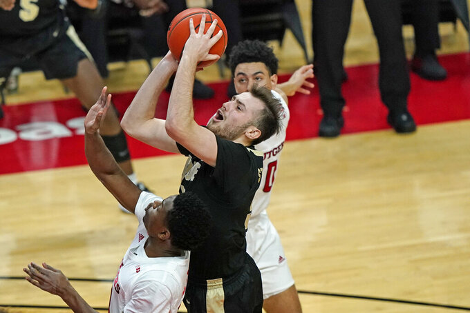 Rutgers guard Geo Baker (0) defends against Purdue guard Sasha Stefanovic (55), who goes up for a shot during the first half of an NCAA college basketball game Tuesday, Dec. 29, 2020, in Piscataway, N.J.. (AP Photo/Kathy Willens)