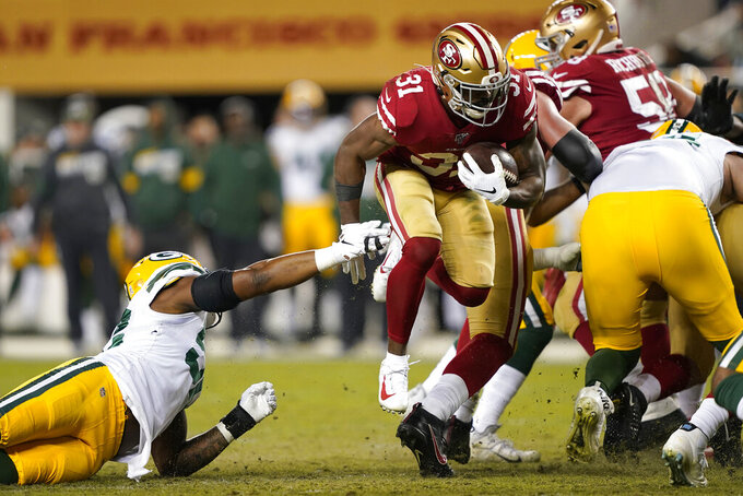 San Francisco 49ers running back Raheem Mostert (31) runs against the Green Bay Packers during the second half of an NFL football game in Santa Clara, Calif., Sunday, Nov. 24, 2019. (AP Photo/Tony Avelar)