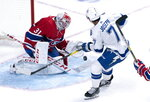 Montreal Canadiens goaltender Carey Price stops a shot by Tampa Bay Lightning's Mathieu Joseph during the second period of an NHL hockey game Tuesday, Oct. 15, 2019, in Montreal. (Paul Chiasson/The Canadian Press via AP)