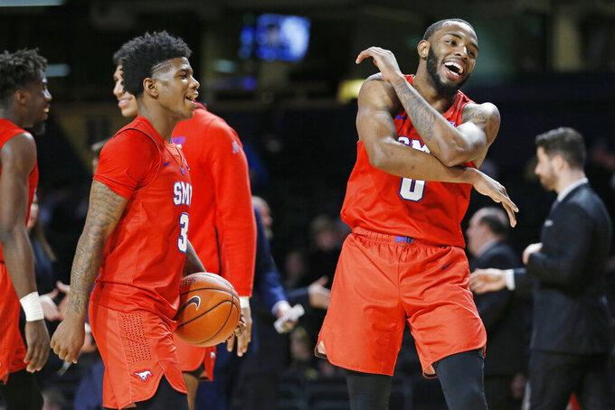 SMU's Kendric Davis (3) and Tyson Jolly (0) celebrate the team's win over Vanderbilt in overtime in an NCAA college basketball game Saturday, Jan. 4, 2020, in Nashville, Tenn. (AP Photo/Mark Humphrey)
