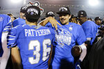 Memphis quarterback Brady White, right, celebrates with placekicker Riley Patterson (36) after they defeated Cincinnati in an NCAA college football game for the American Athletic Conference championship Saturday, Dec. 7, 2019, in Memphis, Tenn. (AP Photo/Mark Humphrey)