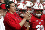 FILE - In this Sept. 8, 2018, file photo, Wisconsin defensive coordinator Jim Leonhard watches during the first half of an NCAA college football game against New Mexico in Madison, Wis. In an era when the College Football Playoff increasingly features the nation's highest-scoring teams, this year's Big Ten race shows defense still matters. (AP Photo/Morry Gash, File)