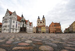"In this Tuesday, Jan. 14, 2020 photo the market place with the Stadtkirche (Town Church) is pictured in Wittenberg, Germany. The church contains a so-called ""Judensau,"" or ""Jew pig,"" sculpture which is located about 4 meters, 13 feet, above the ground on a corner of the church. A court in eastern Germany will consider next week a Jewish man's bid to force the removal of an ugly remnant of centuries of anti-Semitism from a church where Martin Luther once preached. (AP Photo/Jens Meyer)"