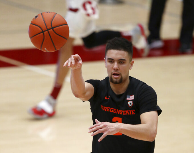 Oregon State guard Jarod Lucas (2) passes the ball against Stanford during the second half of an NCAA college basketball game in Stanford, Calif., Saturday, Feb. 27, 2021. (AP Photo/Josie Lepe)