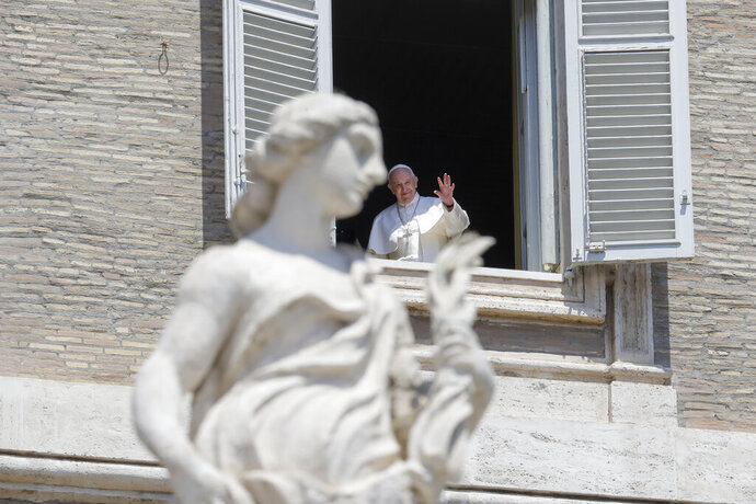 Pope Francis delivers his blessing from the window of his studio overlooking St. Peter's Square, at the Vatican, Sunday, May 24, 2020. For the first time in months, well-spaced faithful gathered in St. Peter's Square for the traditional Sunday papal blessing, casting their gaze at the window where the pope normally addresses the faithful, since the square had been closed due to anti-coronavirus lockdown measures. (AP Photo/Andrew Medichini)