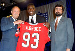FILE - In this April 24, 1988, file photo, Aundray Bruce, center, holds up his future jersey with help from NFL Commissioner Pete Rozelle, left, and Rankin Smith Jr., president of the Atlanta Falcons, in New York. Top overall choice lasted 11 years in league, but made only 42 starts.(AP Photo/Ron Frehm, File)
