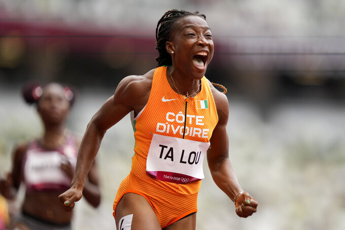 Marie-Josee Ta Lou, of the Ivory Coast, wins a heat in the women's 100-meter run at the 2020 Summer Olympics, Friday, July 30, 2021, in Tokyo. (AP Photo/Martin Meissner)
