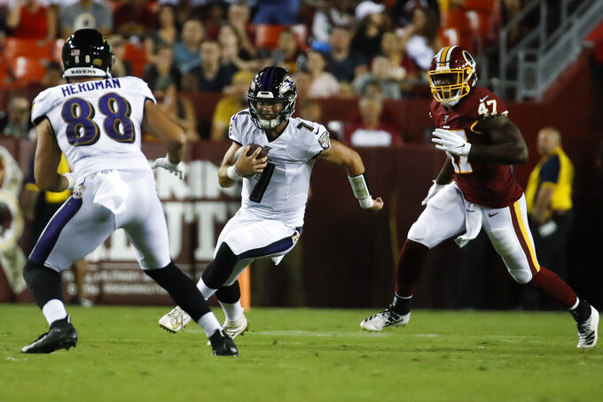 Baltimore Ravens quarterback Trace McSorley (7) scrambles as he is pursued by Washington Redskins linebacker Andrew Ankrah (47) during the first half of an NFL preseason football game Thursday, Aug. 29, 2019, in Landover, Md. (AP Photo/Alex Brandon)