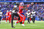 Baltimore Ravens cornerback Marcus Peters (24) breaks up a pass intended for Buffalo Bills wide receiver John Brown (15) during the second half of an NFL football game in Orchard Park, N.Y., Sunday, Dec. 8, 2019. The Ravens won 24-17. (AP Photo/Adrian Kraus)