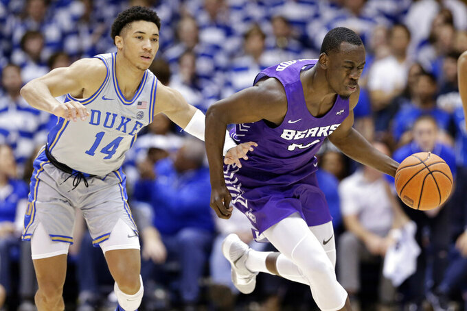 Duke guard Jordan Goldwire (14) guards Central Arkansas guard Collin Cooper during the half of an NCAA college basketball game in Durham, N.C., Tuesday, Nov. 12, 2019. (AP Photo/Gerry Broome)