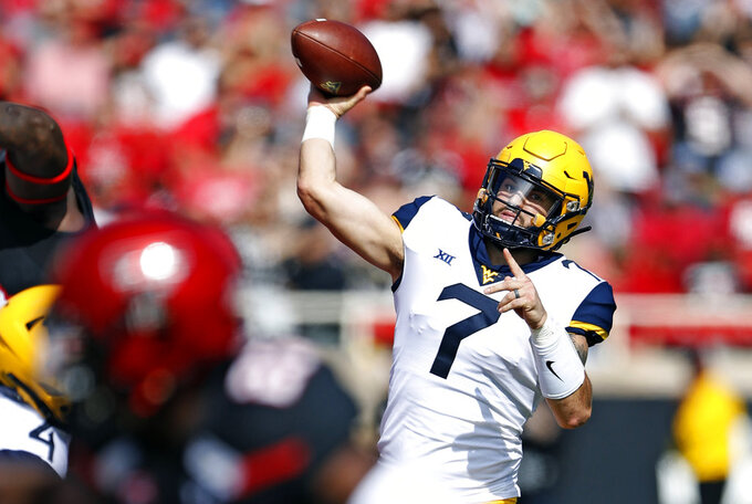 FILE - In this Saturday, Sept. 29, 2018, file photo, West Virginia's Will Grier (7) throws a pass during the first half of an NCAA college football game against Texas Tech,, in Lubbock, Texas. Oklahoma's hopes of making the college football playoff went washing down the Red River, and now West Virginia harbors the Big 12's best hopes of making the party. And the Mountaineers still have a bunch of big tests. (AP Photo/Brad Tollefson, File)