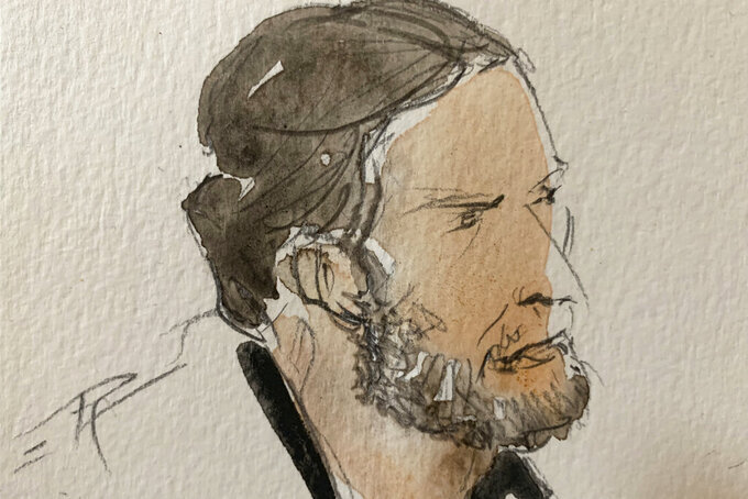 """FILE - This Sept.8, 2021 file courtroom sketch shows key defendant Salah Abdeslam, in the special courtroom built for the 2015 attacks trial, in Paris. The key defendant in the 2015 Paris attacks trial said Wednesday that the Islamic State network which struck the city was attacking France, and that the deaths of 130 people was """"nothing personal."""" (Noelle Herrenschmidt via AP, File)"""