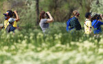 Tracy Aviary and member of the pride community host a guided bird walk for LGBTQIA+ folks and allies along the Jordan River on Saturday, May 15, 2021. (Francisco Kjolseth/The Salt Lake Tribune via AP)