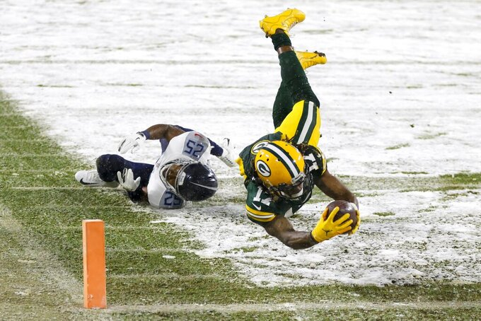 Green Bay Packers' Davante Adams gets past Tennessee Titans' Adoree' Jackson for a touchdown catch during the first half of an NFL football game Sunday, Dec. 27, 2020, in Green Bay, Wis. (AP Photo/Matt Ludtke)
