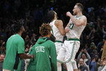Boston Celtics forward Gordon Hayward, right, celebrates with Jayson Tatum (0) after Tatum scored in the final seconds to give the Celtics a 104-102 win over the New York Knicks in an NBA basketball game Friday, Nov. 1, 2019, in Boston. (AP Photo/Elise Amendola)