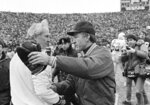 FILE - In this Jan. 8, 1983, file photo, St. Louis Cardinals coach Jim Hanifan, left, and Green Bay Packers coach Bart Starr meet after the Packers' 41-16 victory in an NFL football playoff game in Green Bay, Wis. Hanifan, the former Cardinals coach who returned to the city as offensive line coach to help the Rams win the Super Bowl, has died. He was 87. Hanifan's daughter, Kathy Hinder, told the St. Louis Post-Dispatch that he died Tuesday, Nov. 23, 2020. She said the cause of death hasn't been determined, but said it wasn't related to COVID-19. (AP Photo/Tom Lynn, File)