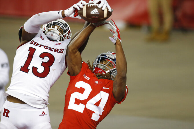 Rutgers tight end Jovani Haskins, left, catches a touchdown pass over Ohio State defensive back Shaun Wade during the second half of an NCAA college football game Saturday, Nov. 7, 2020, in Columbus, Ohio. Ohio State won 49-27. (AP Photo/Jay LaPrete)