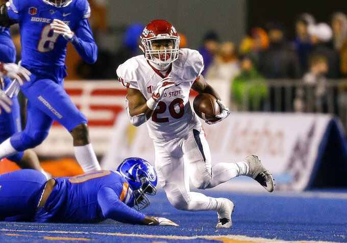 Fresno State running back Ronnie Rivers (20) runs with ball against Boise State in the second half of an NCAA college football game, Friday, Nov. 9, 2018, in Boise, Idaho. Boise State won 24-17 over Fresno State. (AP Photo/Steve Conner)
