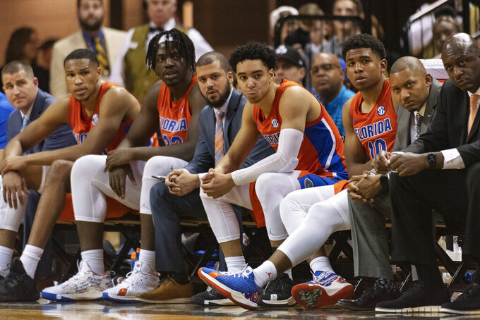 The Florida basketball team watches the final minute of the second half of an NCAA college basketball game against Missouri, Saturday, Jan. 11, 2020, in Columbia, Mo. (AP Photo/L.G. Patterson)
