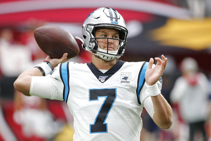 Carolina Panthers quarterback Kyle Allen (7) warms up prior to an NFL football game against the Arizona Cardinals, Sunday, Sept. 22, 2019, in Glendale, Ariz. (AP Photo/Rick Scuteri)