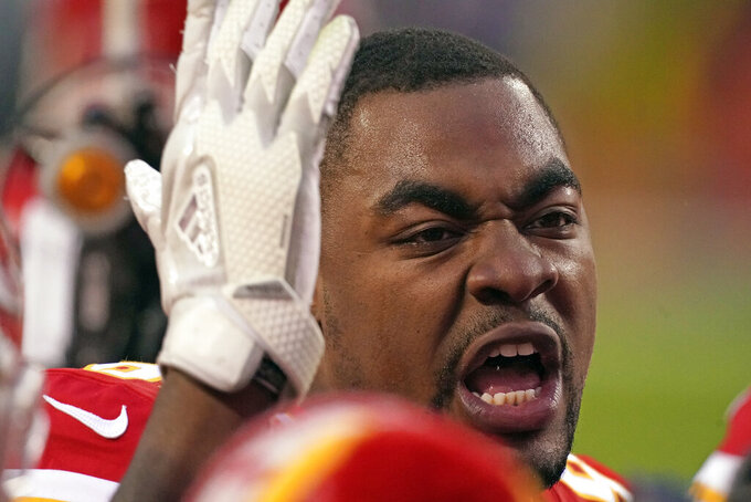 Kansas City Chiefs defensive tackle Chris Jones talks with teammates before the AFC championship NFL football game against the Buffalo Bills, Sunday, Jan. 24, 2021, in Kansas City, Mo. (AP Photo/Charlie Riedel)