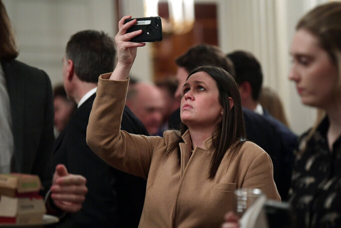 White House press secretary Sarah Huckabee Sanders attends the reception for the Clemson Tigers in the State Dining Room of the White House in Washington, Monday, Jan. 14, 2019. (AP Photo/Susan Walsh)