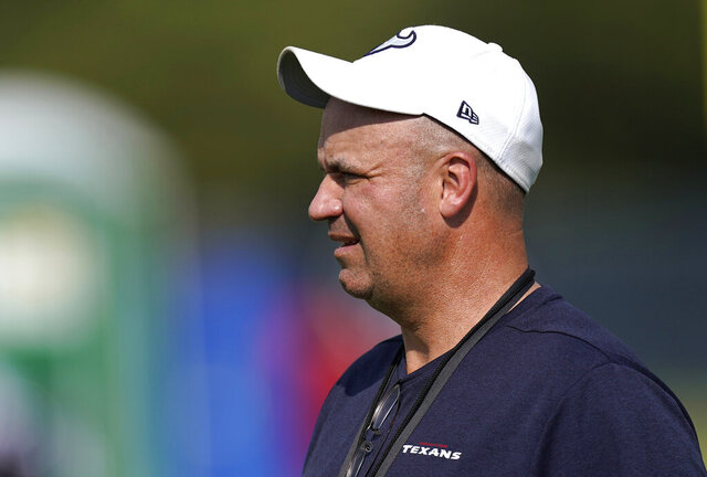 FILE - In this Aug. 21, 2020, file photo, Houston Texans coach Bill O'Brien watches during an NFL football training camp in Houston. Alabama has hired former Texans coach O'Brien as offensive coordinator and quarterbacks coach. Crimson Tide coach Nick Saban announced the hiring on Thursday, Jan. 21, 2021. O'Brien is replacing Steve Sarkisian, who left to become head coach of the Texas Longhorns after the national championship game. (AP Photo/David J. Phillip, File)