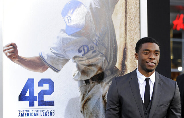 FILE - In this Tuesday, April 9, 2013 file photo, Chadwick Boseman, who plays baseball legend Jackie Robinson in